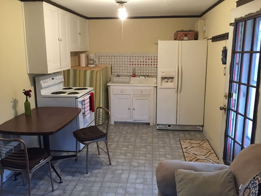 Full kitchen with a coffee maker, pots and pans if you want to have a home cooked meal.
