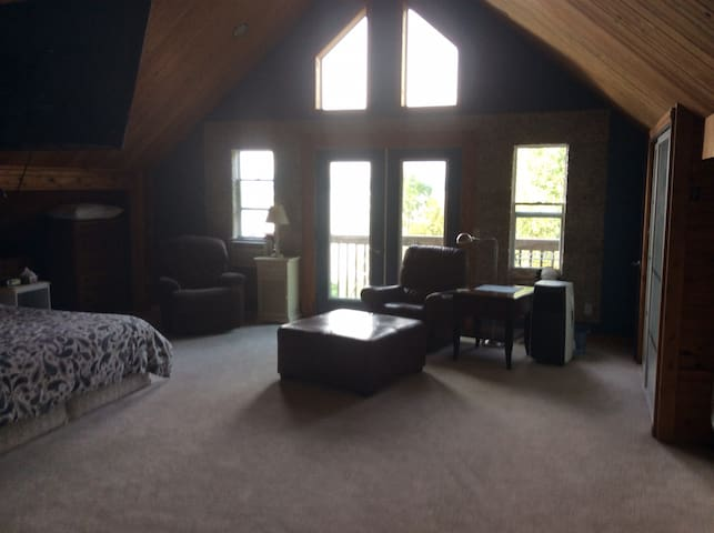Master bedroom with 55 inch TV with full cable package