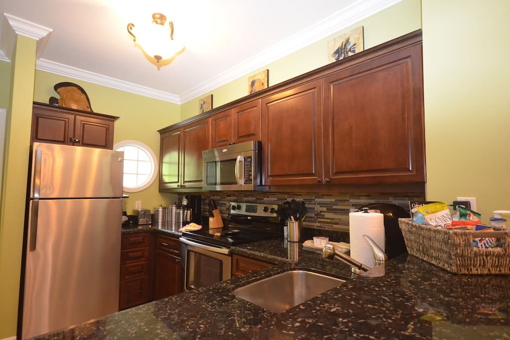 Fully stocked, recently renovated kitchen with granite and stainless appliances.