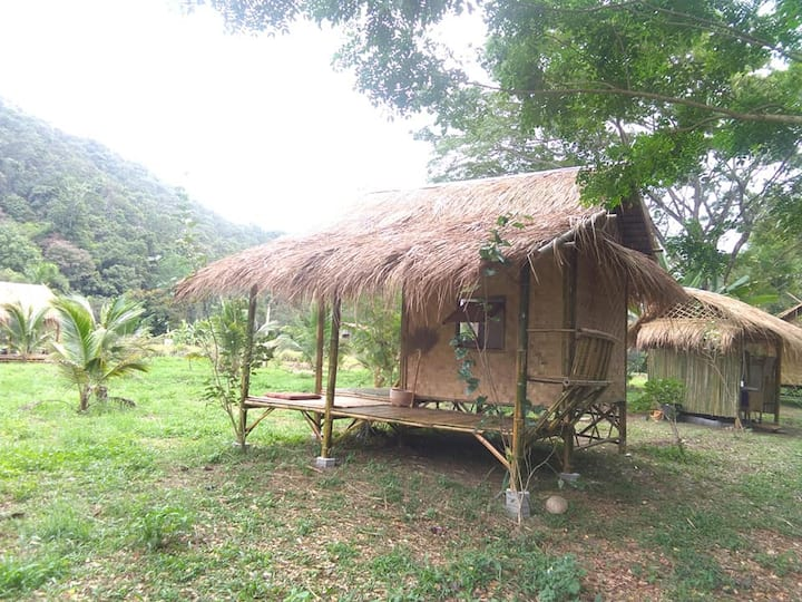 Simple life in a bamboo hut in jungle land