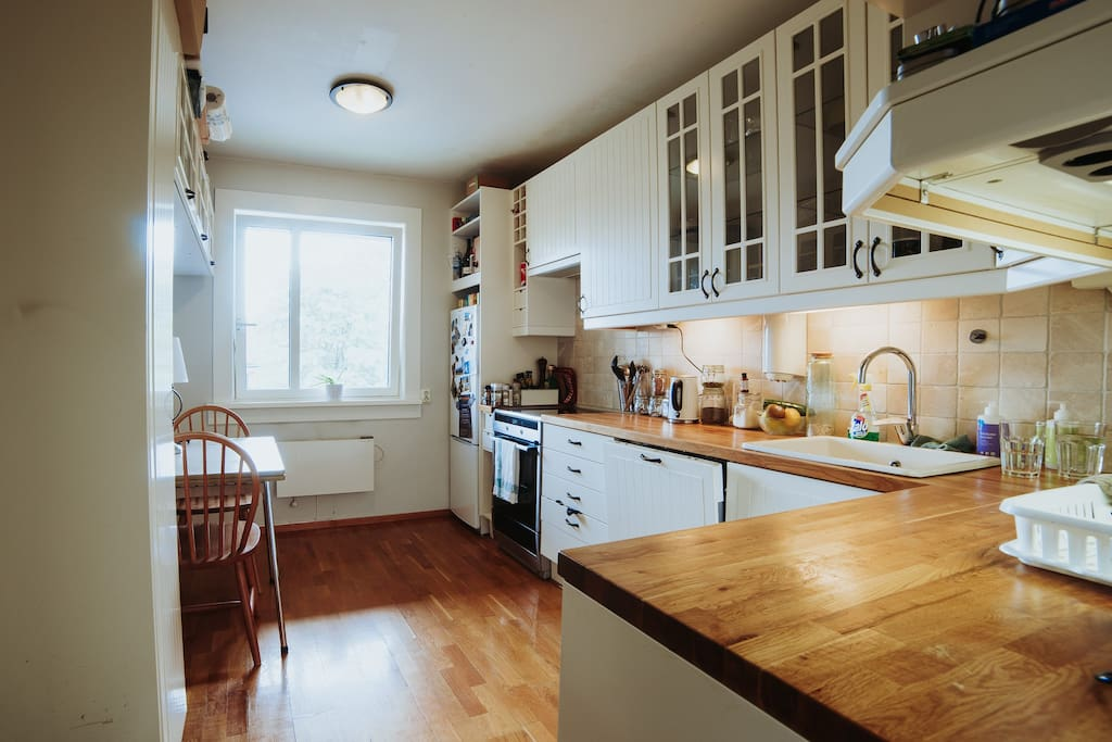 Kitchen with washer and stve