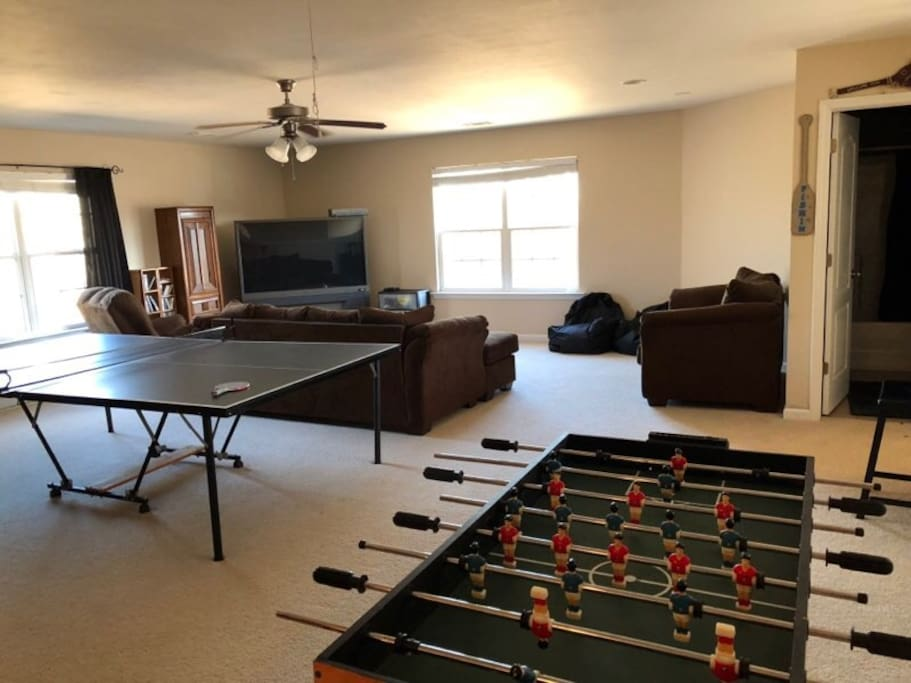 Great Room with ping pong, fooseball, and poker tables.