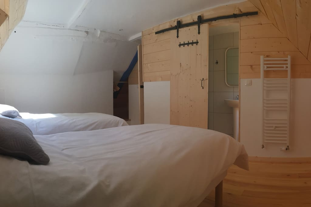 Your bedroom (with beds made up as singles)