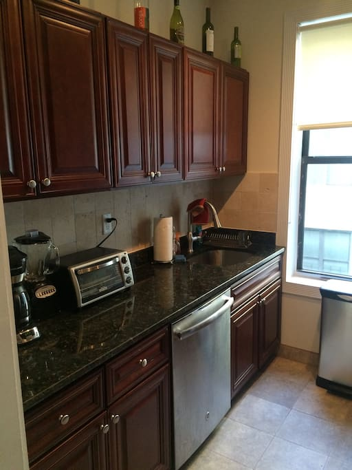 Brand new fully stocked kitchen with dishwasher and appliances.