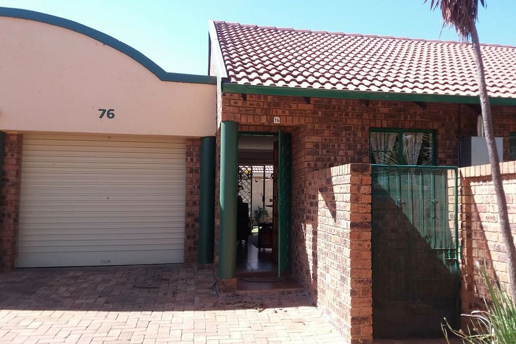 Front of house, private entrance with parking space.