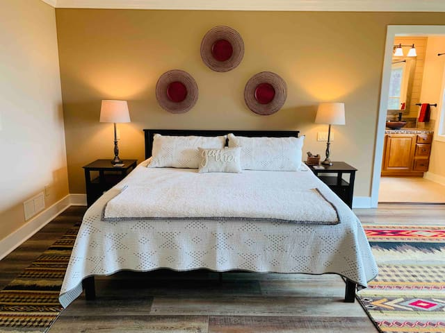 King sized bed in the master bedroom.