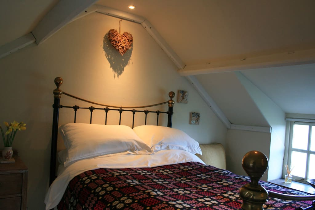 Cosy double bedroom with traditional Welsh blankets