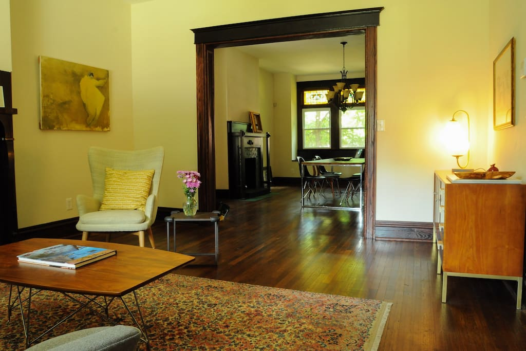 Living room and dining room.  All the way to the back is a fantastic little window seat.  Perfect for coffee in the morning.