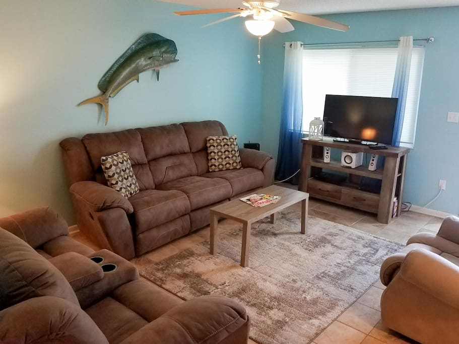 Get into vacation mode with a living room outfitted with beachy decor and comfortable furniture.