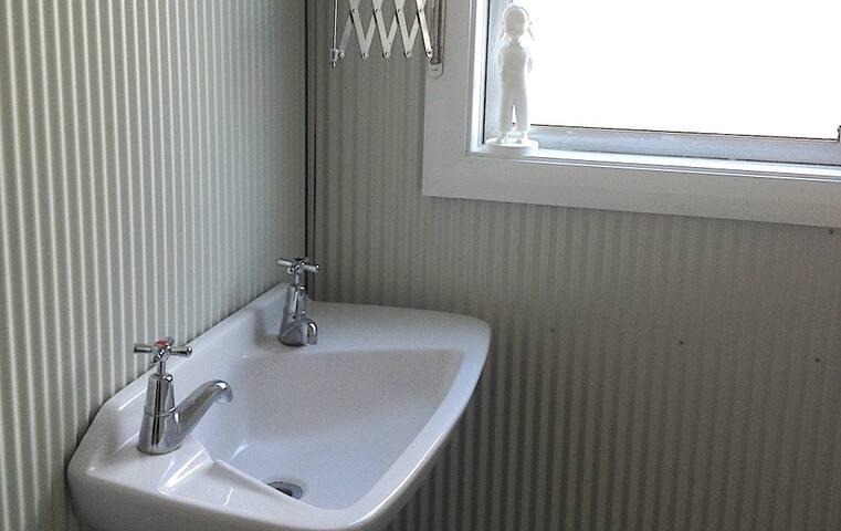 Corrugate clad bathroom