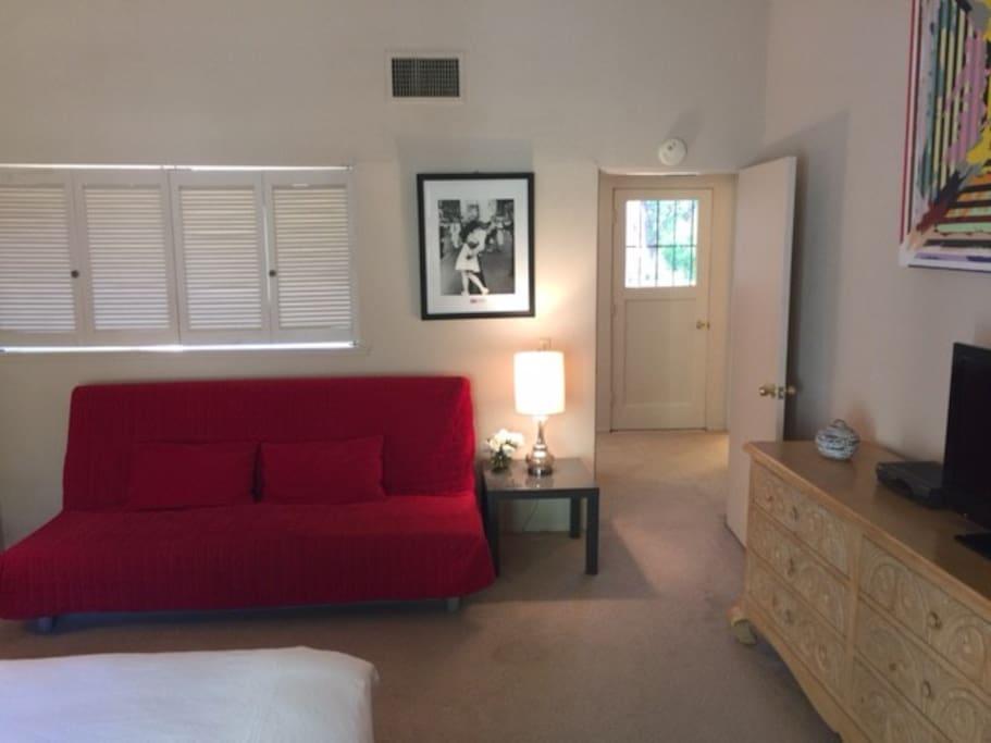 Bedroom facing door to roof-deck
