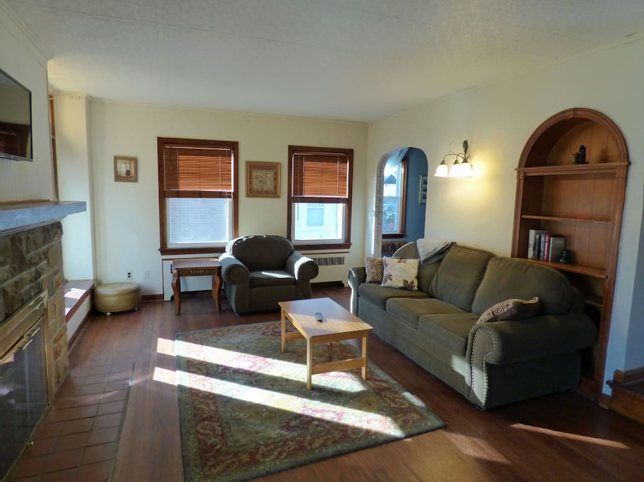 Relaxing living room with TV, comfy pull out couch, Wi-Fi and working fireplace.