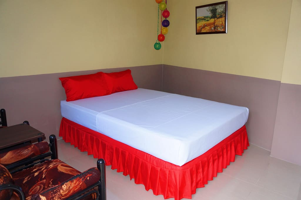 Room 7 - Superior Room with queen size bed, Aircon, TV, couch, toiletries and Comfort room with shower.
