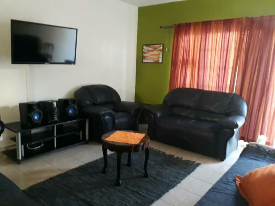 Living room with TV and hi fi. No DSTV. Seats up to 9 people.