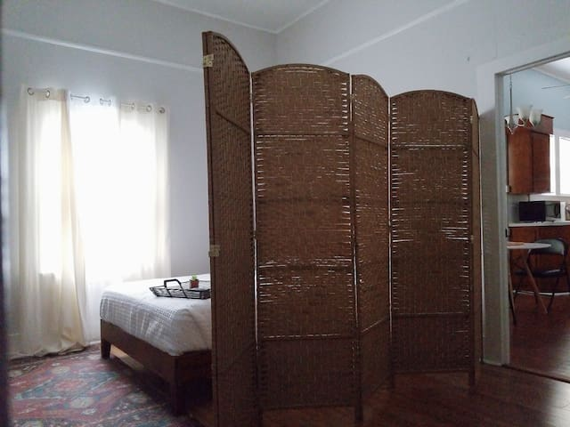 Bedroom 1: **Please note this bedroom is a shotgun style (walk-through bedroom) . It doesn't have a door but does include a large folding screen for your sleeping privacy