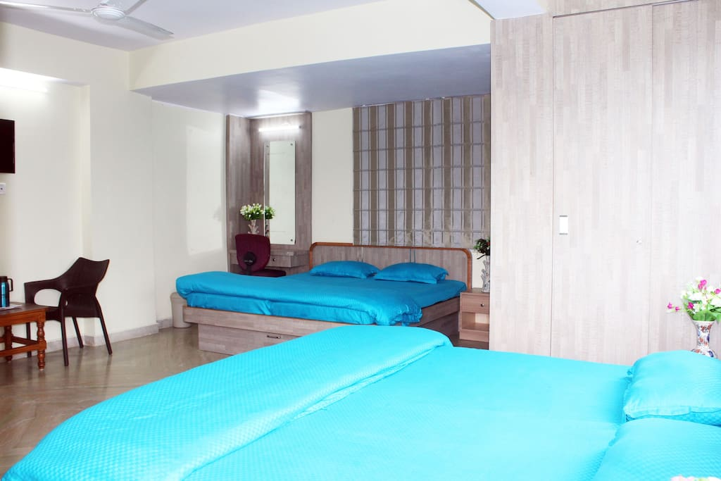 There are 2 King Size Beds, Att. Bath, Wardrobes, Dressing cum Study Table, Chairs, Centre and Side Tables provided with