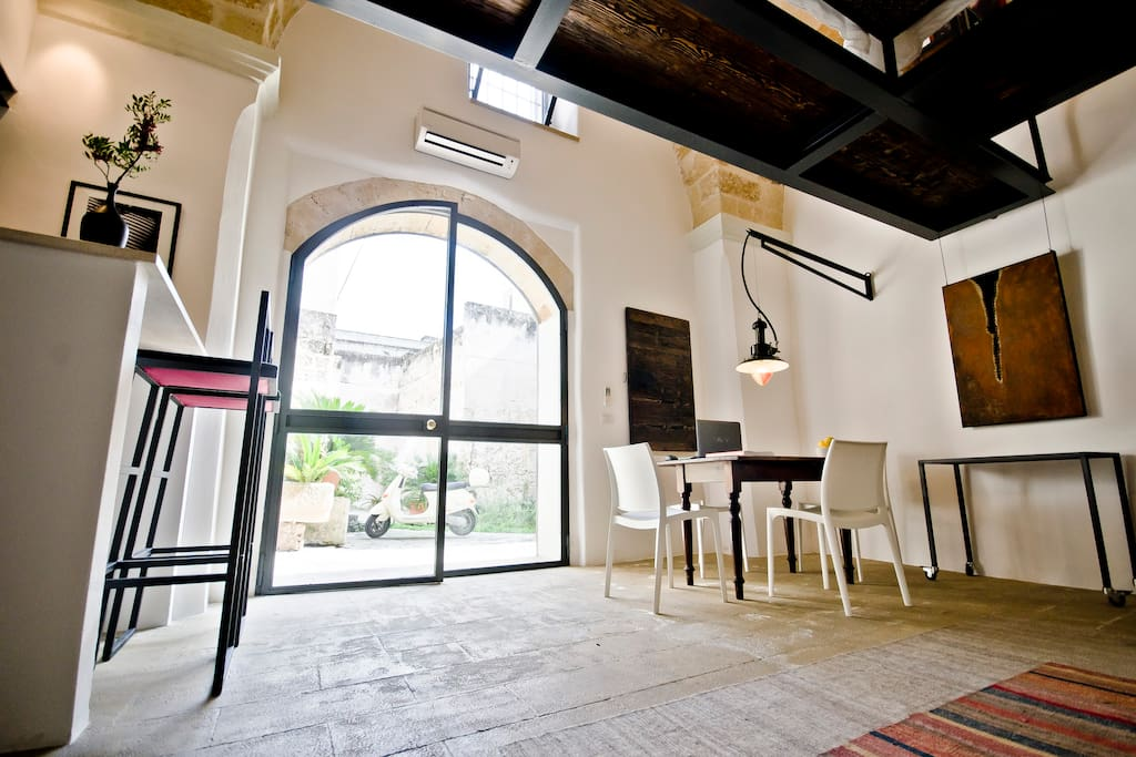 The spacious open floor plan is highlighted with arched doors and a floating sleeping loft.