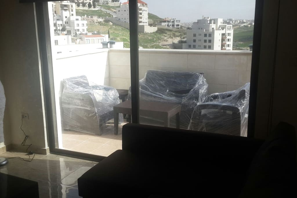 The living room window over looking to the terrace & Dear Ghebar & Abdoun area