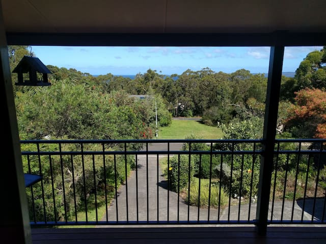 The balcony looks out to Jervis Bay - sunny in the morning and shady the rest of the day.  You may also see Stanley the kangaroo eating grass in the field and plenty of parrots in the trees.
