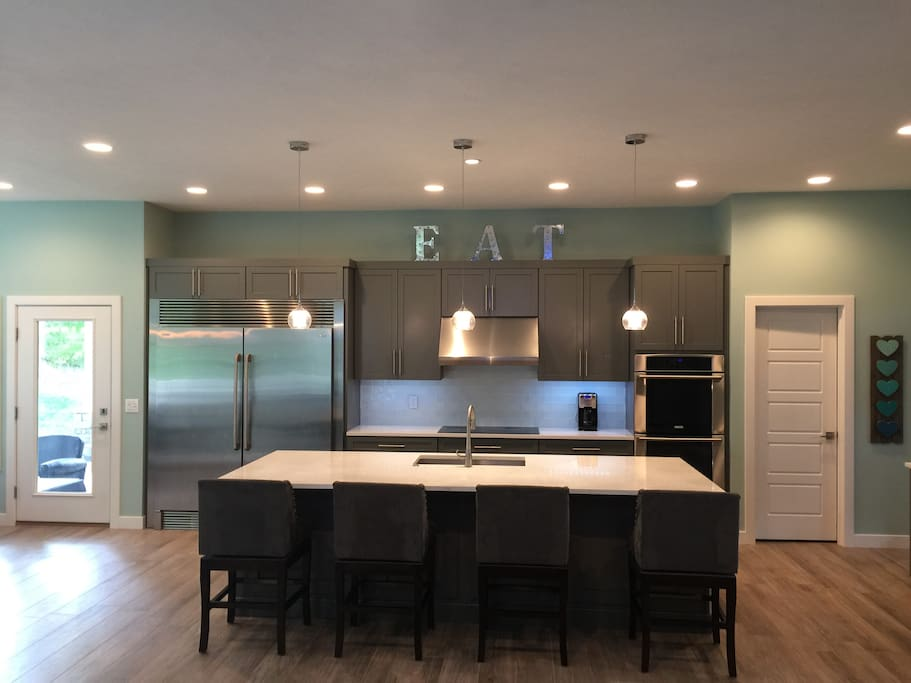 Eat in kitchen, 12 foot island and 60 in refrigerator-freezer