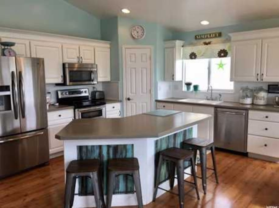 Deluxe fridge, with double convection ovens, microwave, toaster oven, dishwasher and disposal.