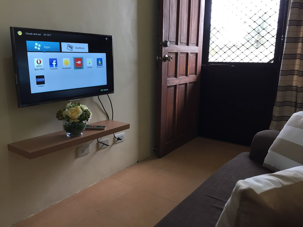 living area, couch, smart TV
