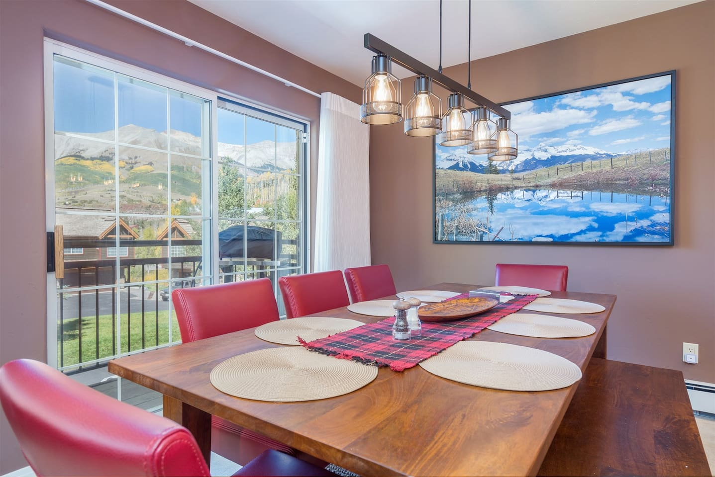 Dining area with seating for 8 as gorgeous views pour in from outside