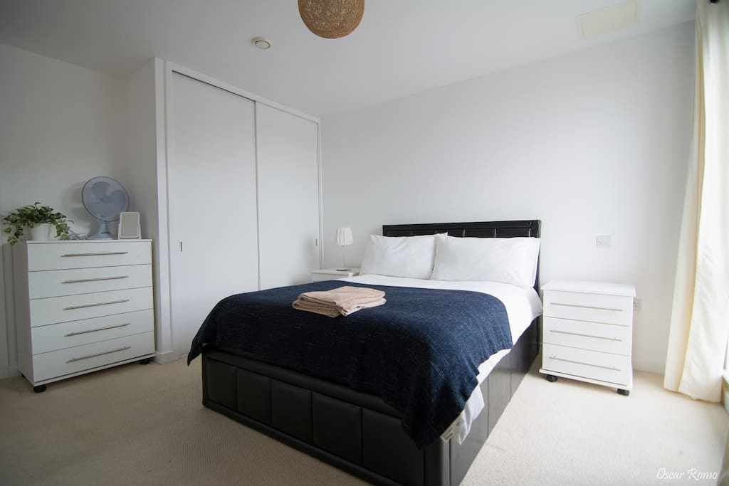 Spacious bedroom with comfy bed