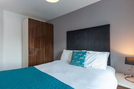 Comfortable king size bed in our 1 bed standard apartment
