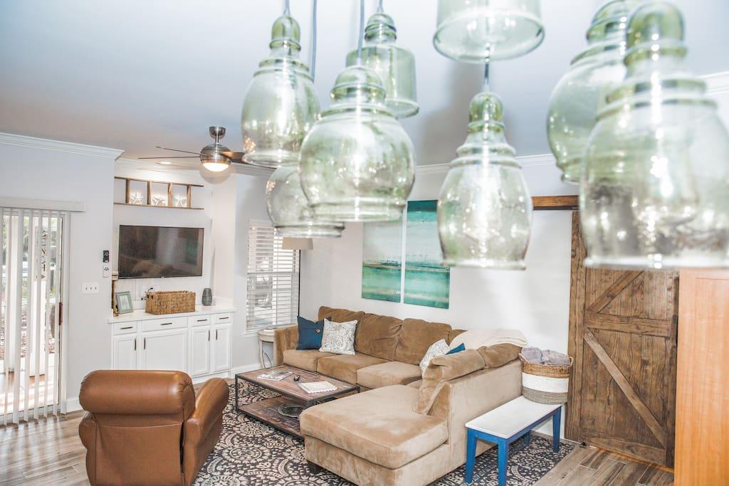 Beautiful blown glass pendant chandelier overlooking the living room