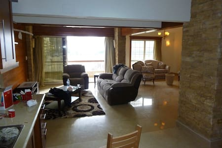 Nice, quiet, safe and well-kept 5-story bldg. The area is home to many foreigners. A view of  a massive green central park, which allows for great lighting and airflow. Near Supermarket. Hi-speed internet. Brand-new appliances. USD 285/month