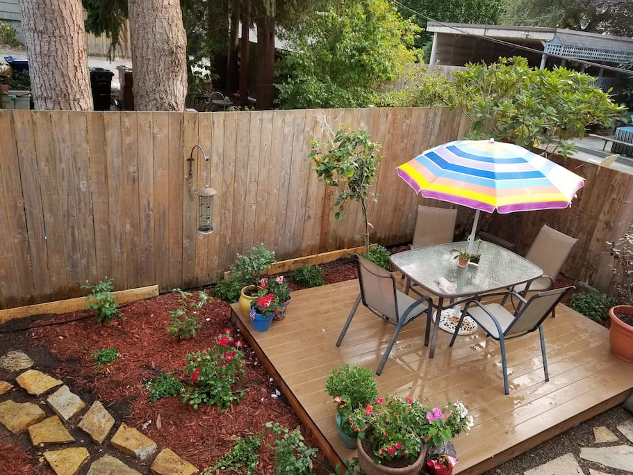 Back yard rose garden and deck area