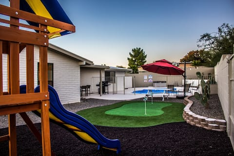 Back yard features swing-set, putting green, picnic table and pool.