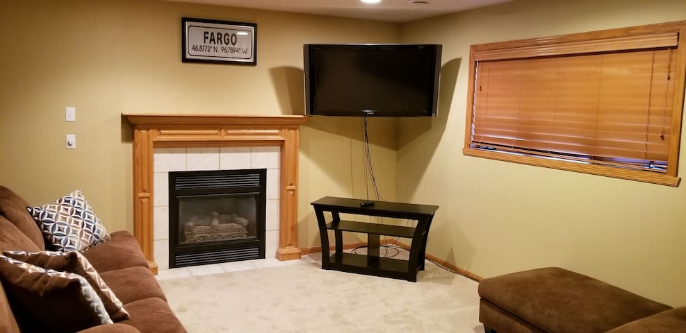 Downstairs living room (2 couches, TV w/Dish Network, and fridge)