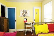 The entire house is an art gallery with vibrant pieces for sale which can be shipped to you.