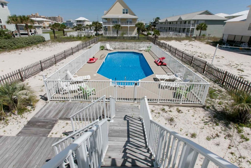 Backyard with private gated pool and sand volleyball