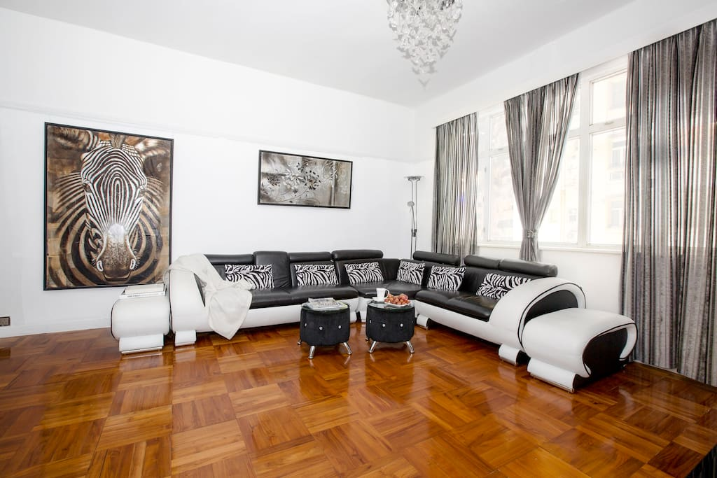 Vibrant living area with entertainment system, dining room, PS3 and WIFI.