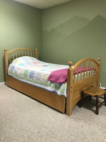 This twin bed is located in the basement den with a trundle bed.  Very suitable for those addition guests.