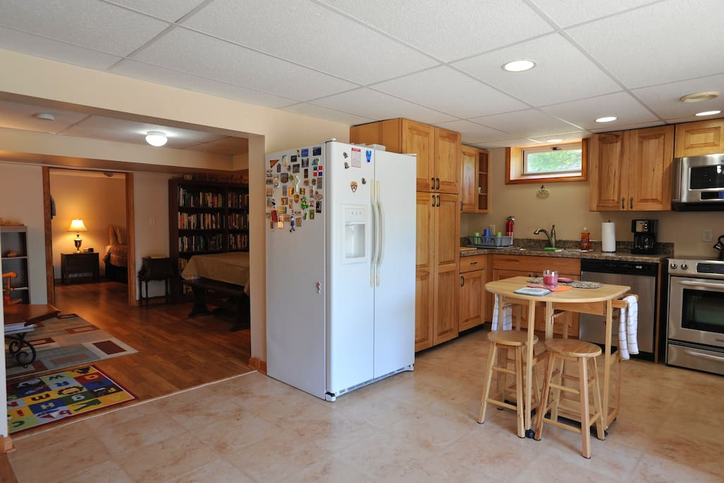 Walk through French door to kitchen leading to dining room/library and into large bedroom.