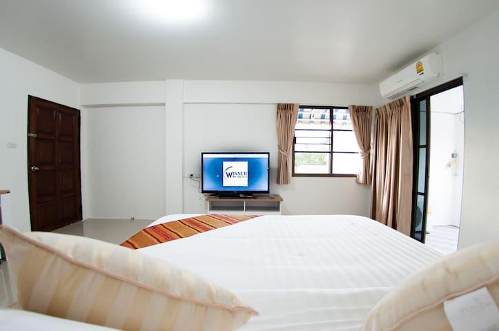 Winner Residence on Bed
