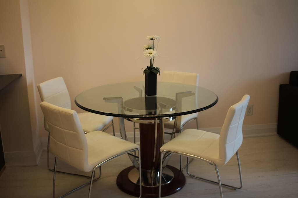 Dining Room. Leather chairs with an Italian glass table