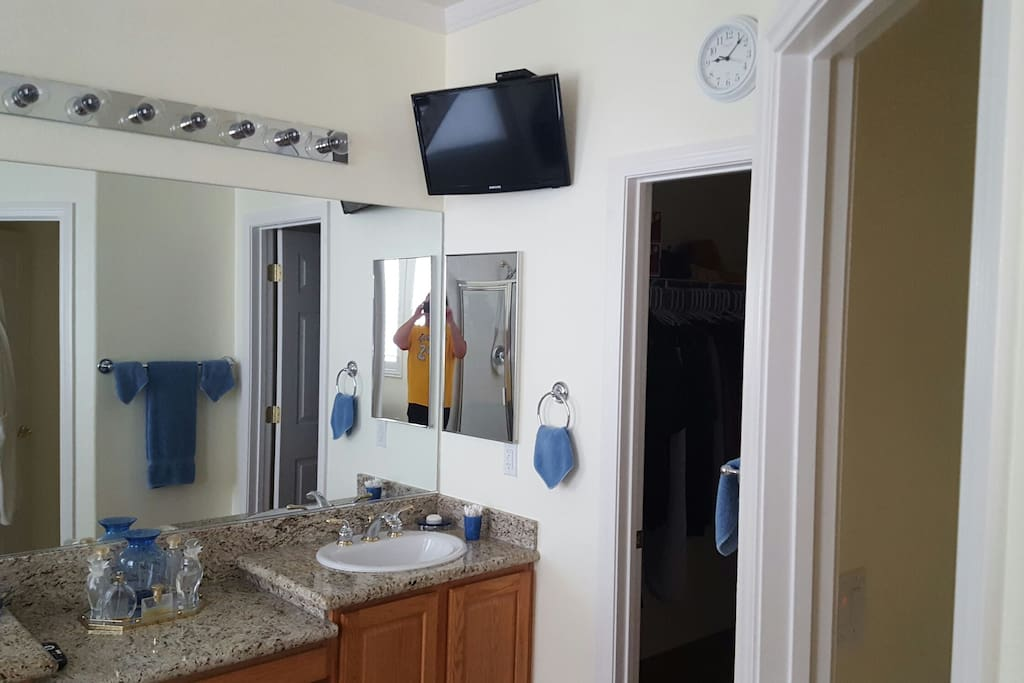 Your own private bathroom attached to your bedroom, with His 'n' Hers bathroom sinks. Wall mounted TV.