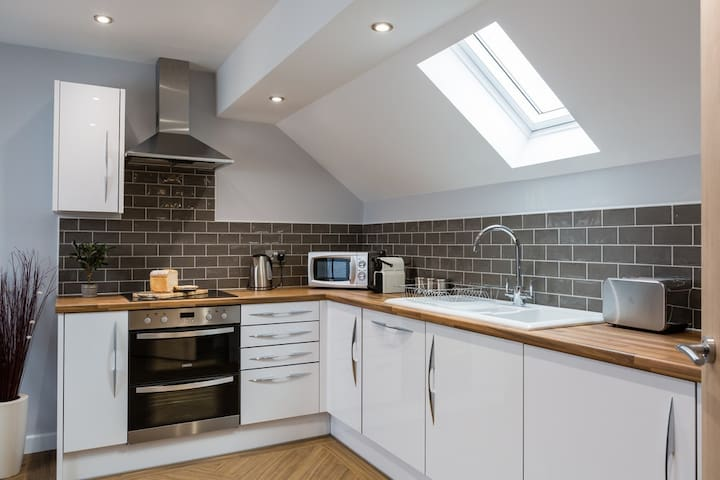 contemporary open plan fully equipped  kitchen