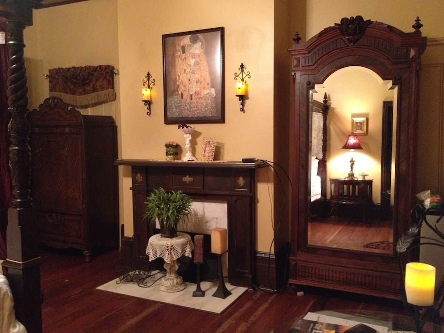 Non working fireplace and mantel adorns your bedroom. Antique armoire for hanging your clothing.