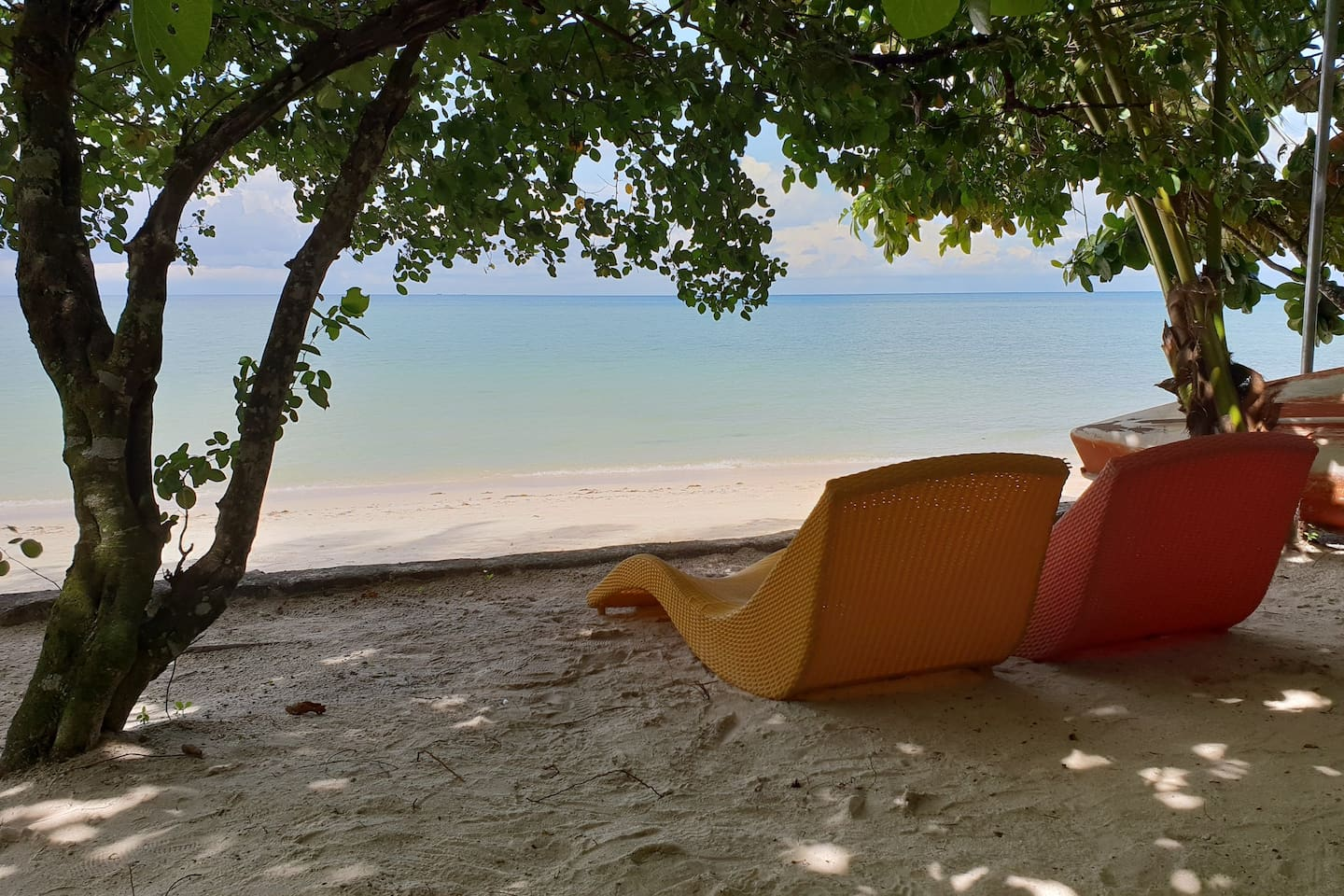 The most relaxing beach in Belitung, laying under the tree watching blue ocean in front of you