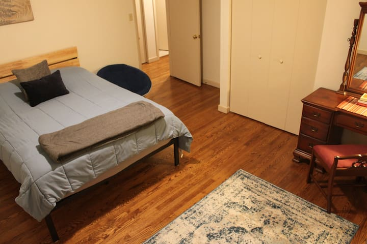 Bedroom #2, the corner room, features a queen bed and a pack & play (stored in closet).