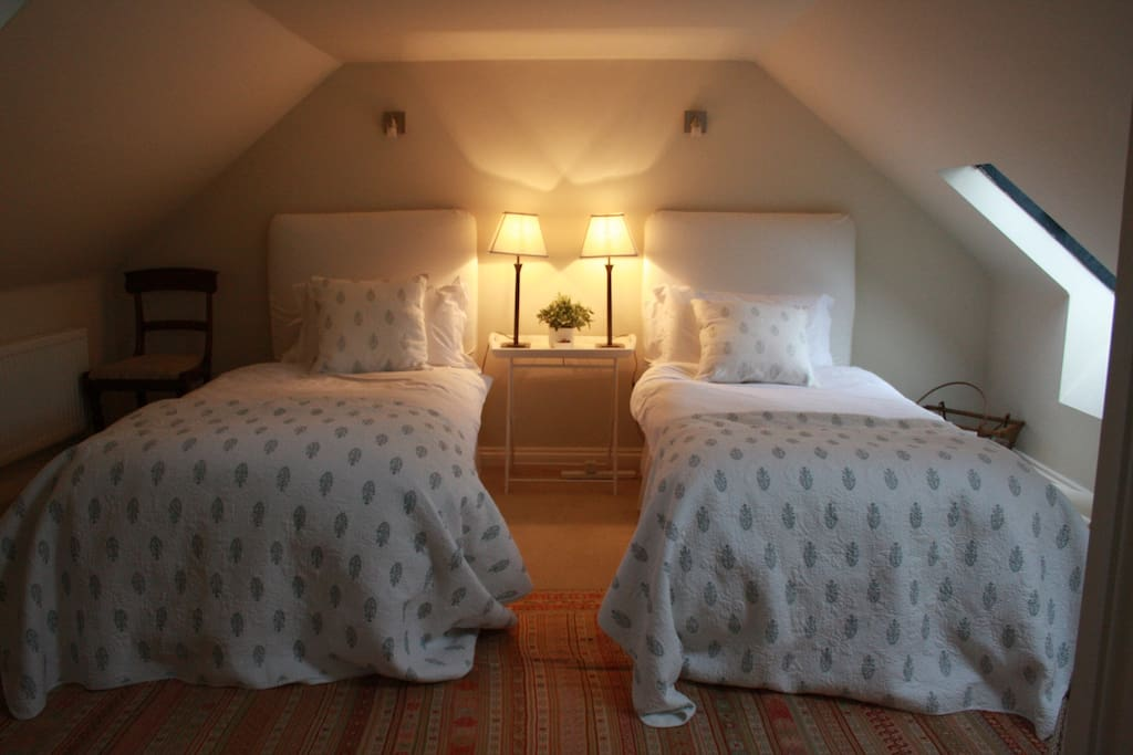 The room comprises two single beds on the top floor with its own ensuite