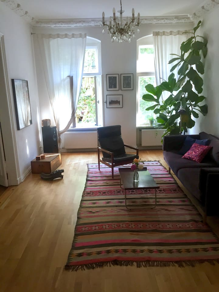 bright living room with comfy over-sized sofa and tv