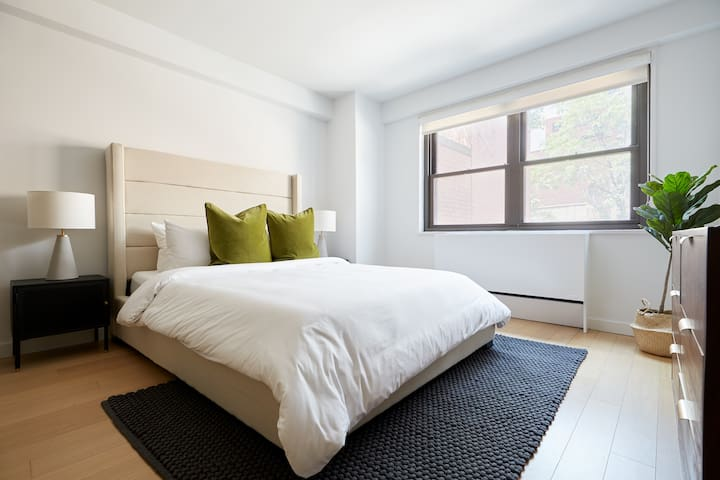 Queen-size bed in living area