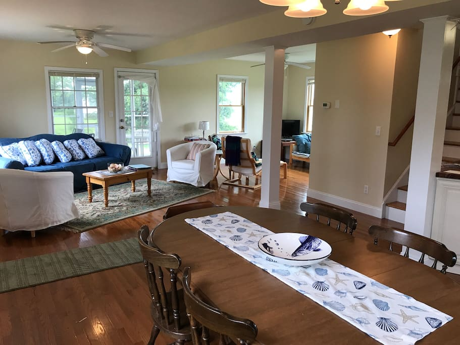 view of open floor plan from dining room into living room and media space